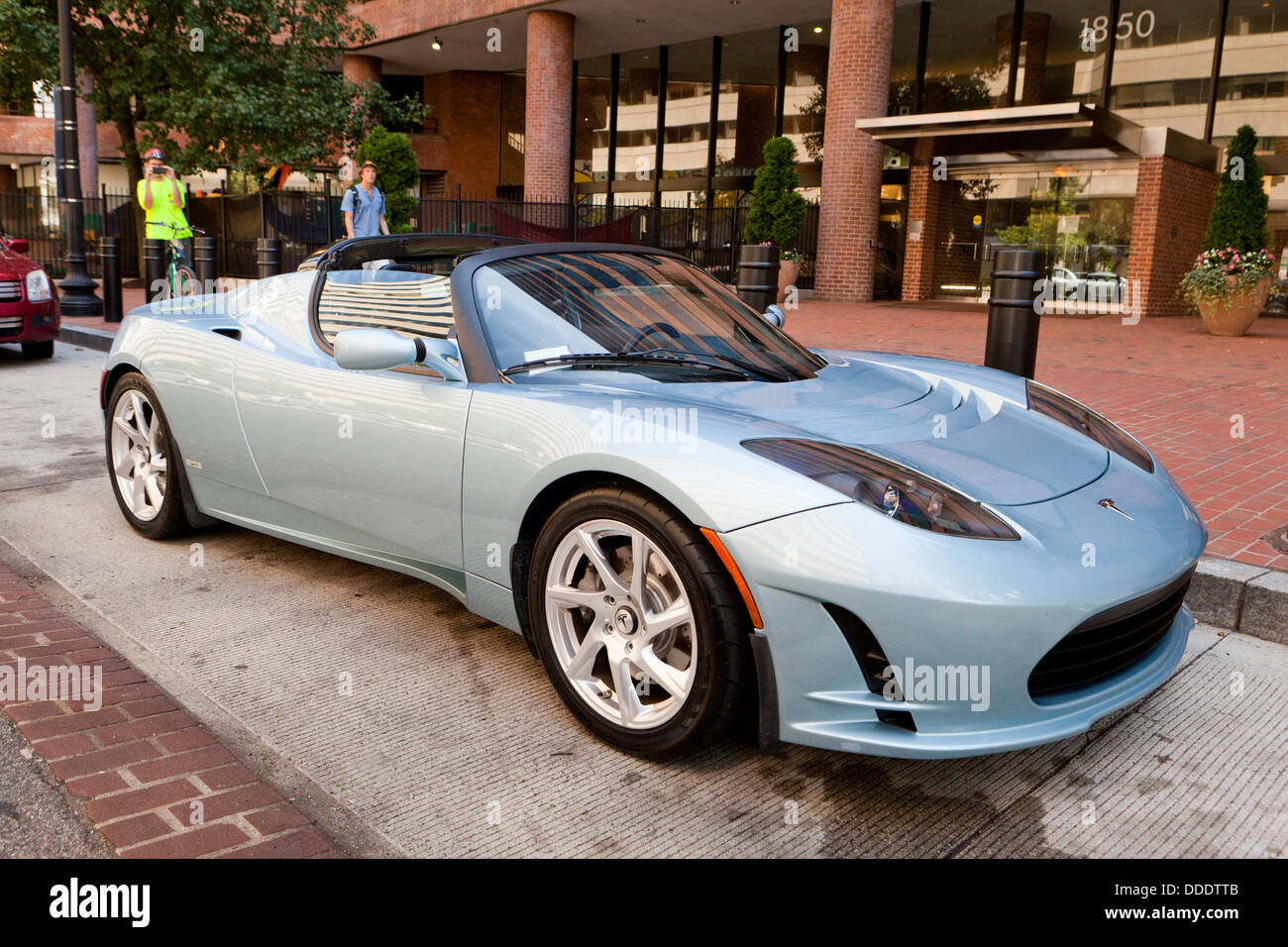 Tesla Roadster Sport 2.5 electric car parked in front of office building - USA - Stock Image