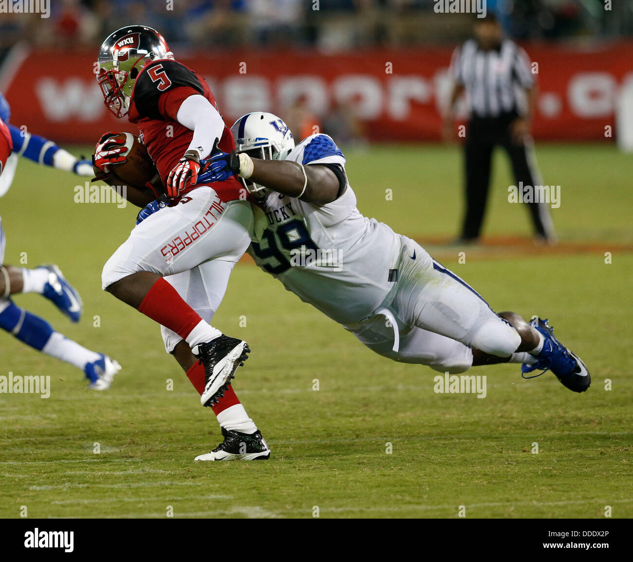 Aug. 31, 2013 - Nashville, TN, USA - Kentucky Wildcats defensive tackle Donte Rumph (99) laid out to bring down - Stock Image