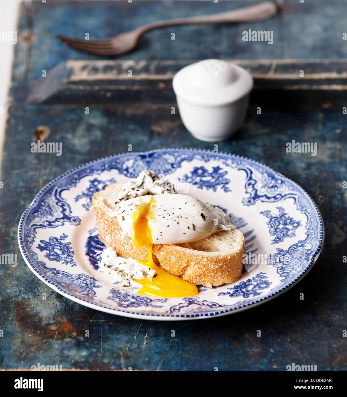 Breakfast with bruschetta with poached egg Stock Photo