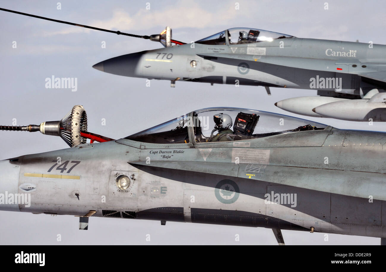 Royal Canadian Air Force CF-18 Hornet fighter aircraft assigned to the 409 Tactical Fighter Squadron refuel during Stock Photo
