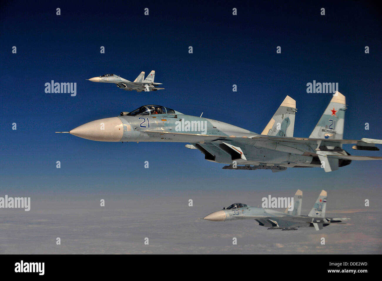Russian Federation Air Force Su-27 fighter aircraft intercept a simulated hijacked aircraft during Exercise Vigilant - Stock Image