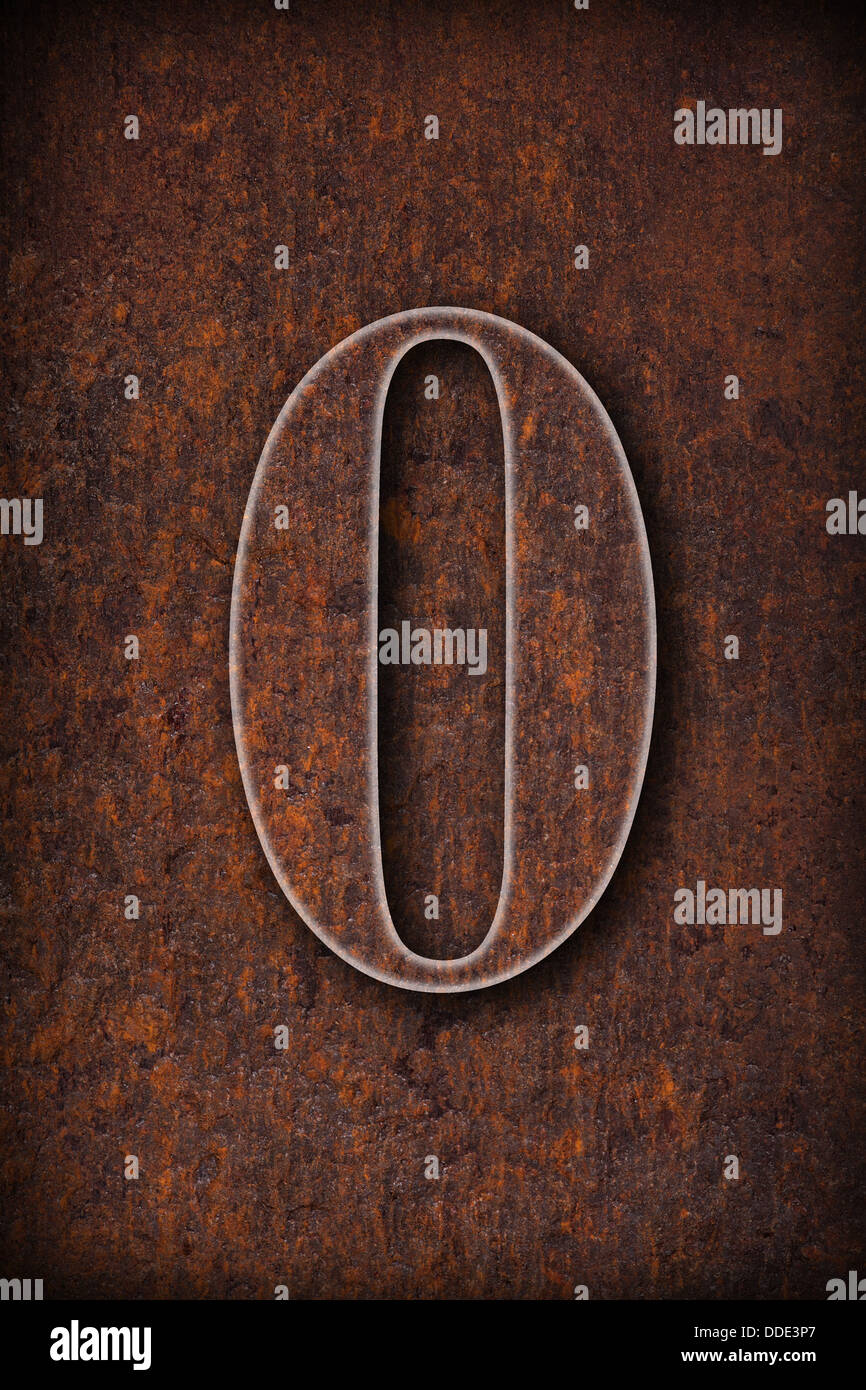 zero number on rusty iron brown background - Stock Image