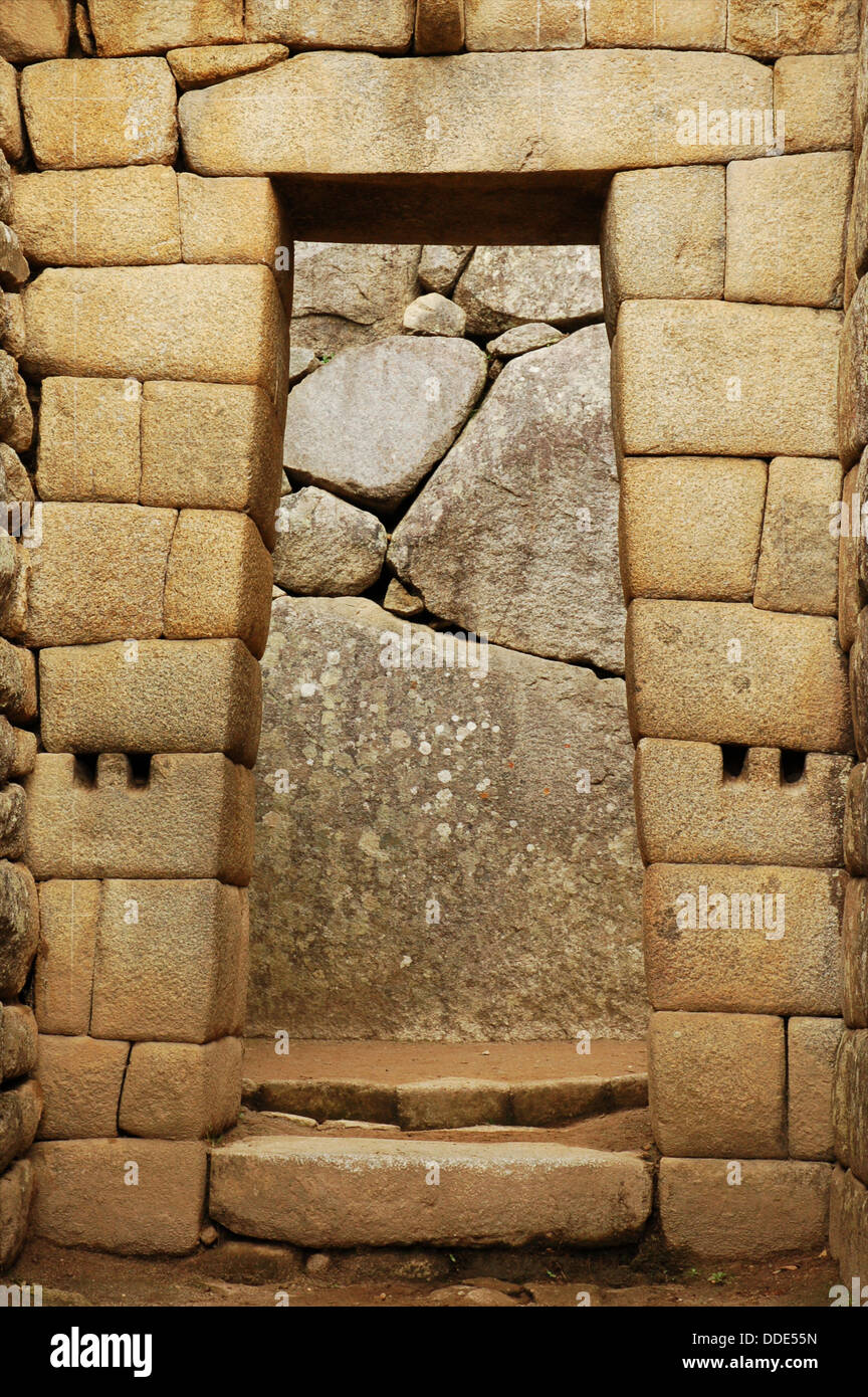 Typical trapezoidal Inca door at Machu Picchu, Peru - Stock Image