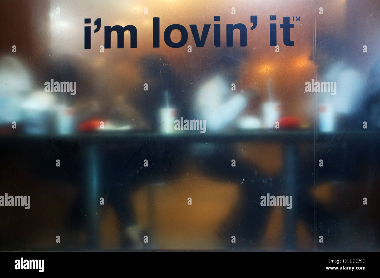 McDonald's fast food restaurant with 'I'm loving it' slogan on the window in Central Mumbai, India. - Stock Image