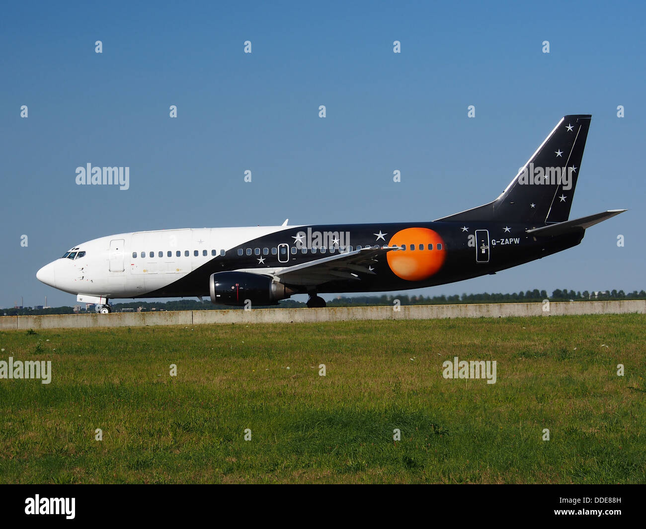 G-ZAPW Titan Airways Boeing 737-3L9(QC) - cn 24219 taxiing 21july2013 pic-001 - Stock Image