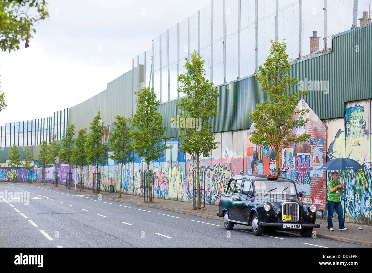 The peace wall in west Belfast keep the catholics and Protestants from fighting, is covered in art for peace in - Stock Image