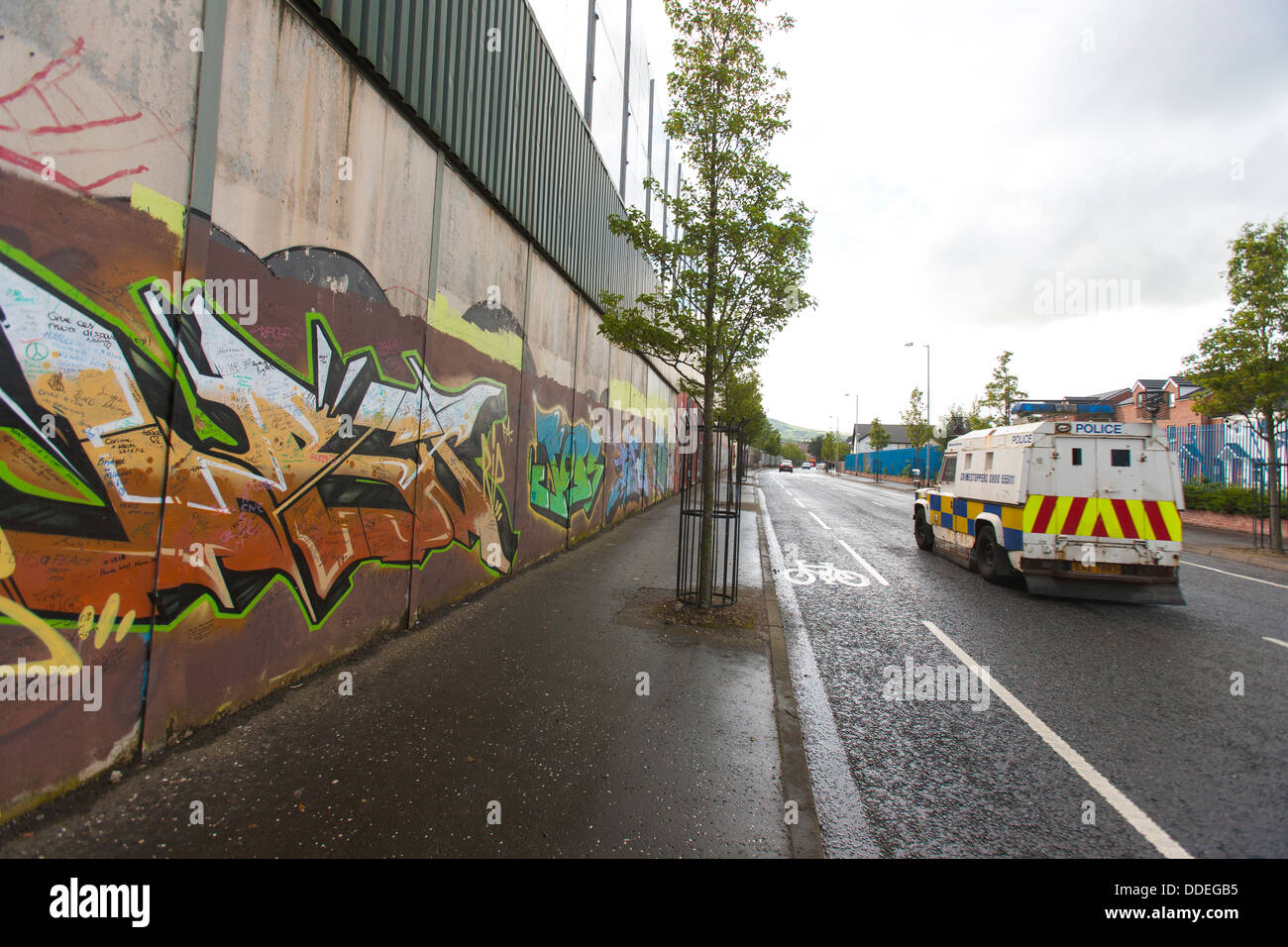 The peace wall in west Belfast keep the catholics and Protestants from fighting and are closed at night in Northern - Stock Image