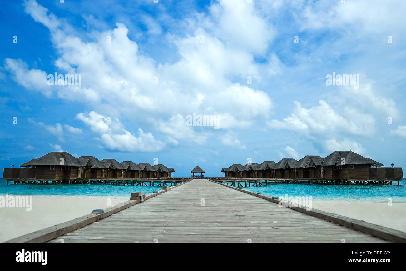 Island in the Ocean with houses - Stock Image