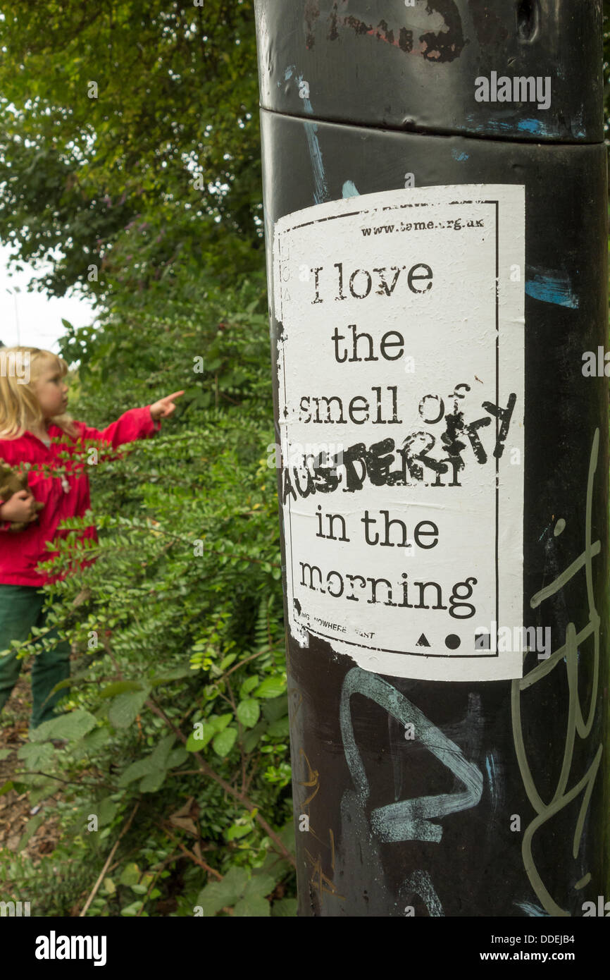 Sheffield, UK. 01st Sep, 2013. A young girl appears to point to a poster protesting the UK Government's financial - Stock Image
