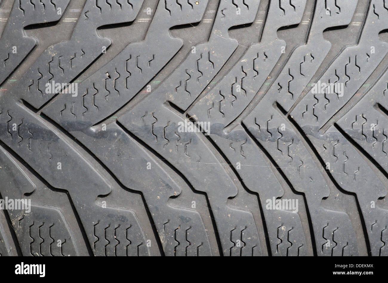 Close up of worn winter car tyre tread - Stock Image