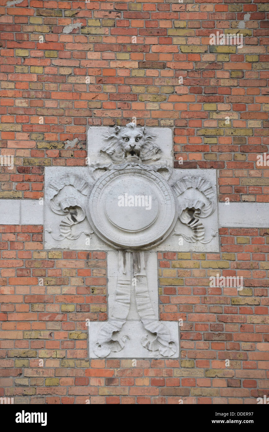 A stone cross at a facade of a house in Antwerp. - Stock Image