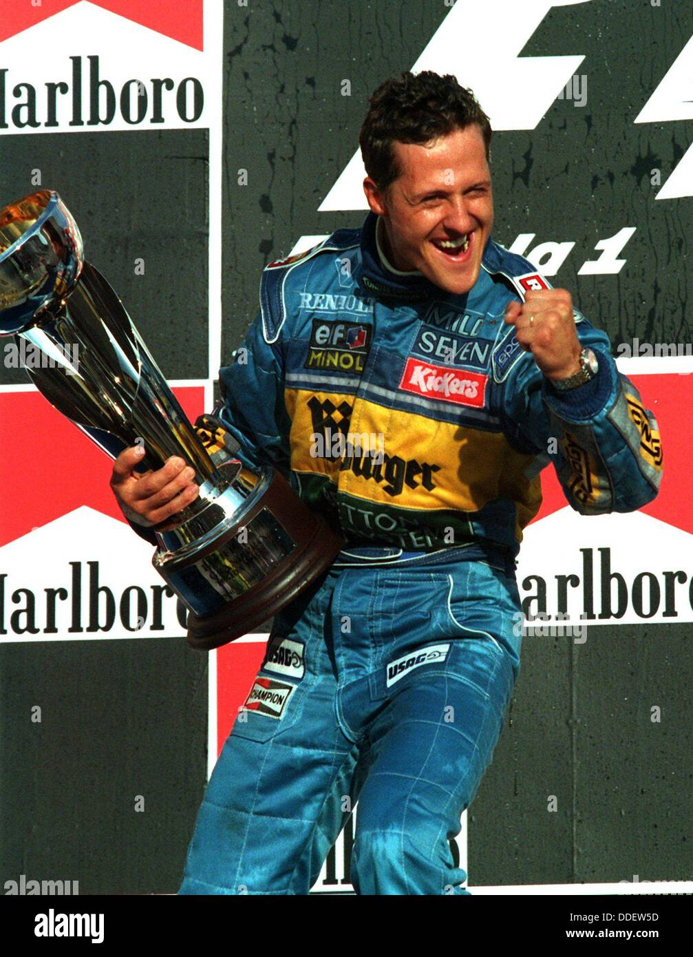 Michael Schumacher is world champion and holds the cup in his hand on the 22nd of October in 1995. He will end his - Stock Image