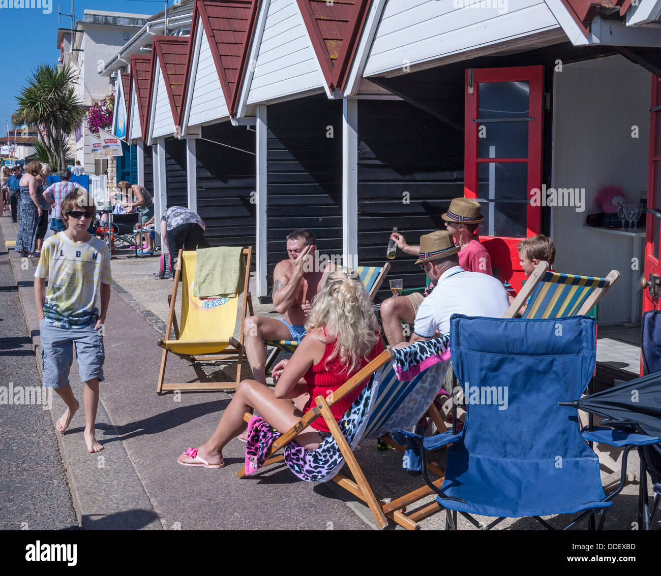 Bournemouth Beach Huts with holidaymakers, Dorset, England, UK. - Stock Image