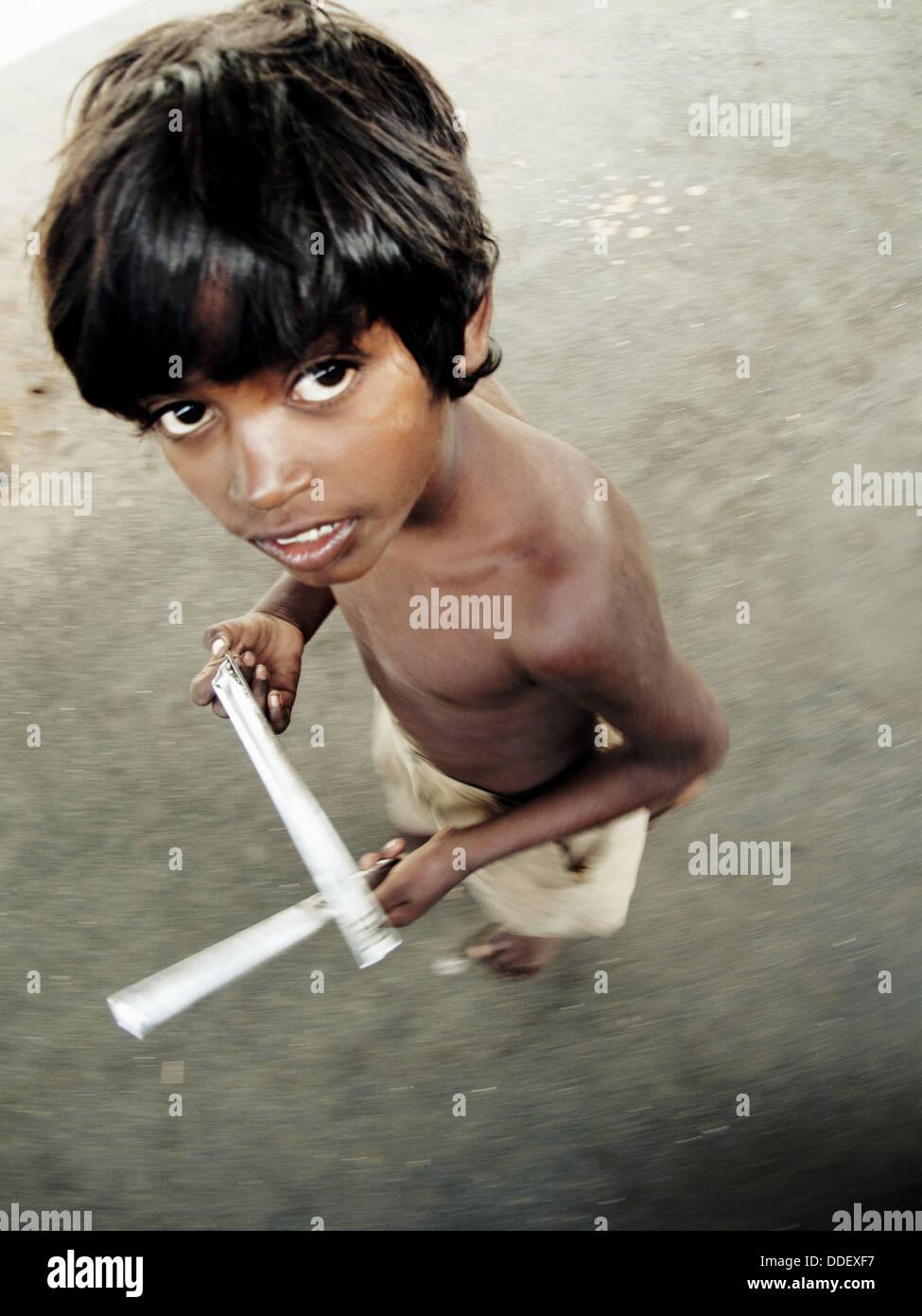 Untouchable boy in a station, Mumbai, Maharashtra, India Stock Photo