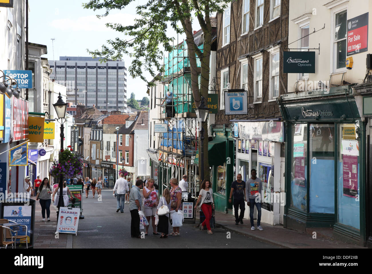 Maidstone Town Centre. A pedestrianized street lends itself to conversations between passing people. - Stock Image