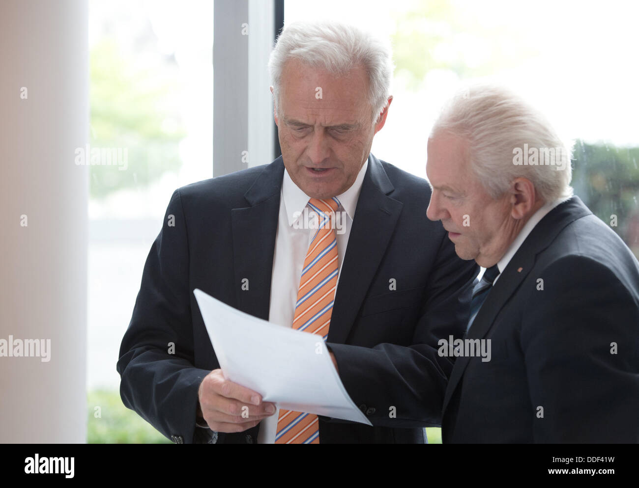 Berlin, Germany. 02nd Sep, 2013. German Transport Minister Peter Ramsauer (CSU, L) and the chairman of the Deutsche - Stock Image