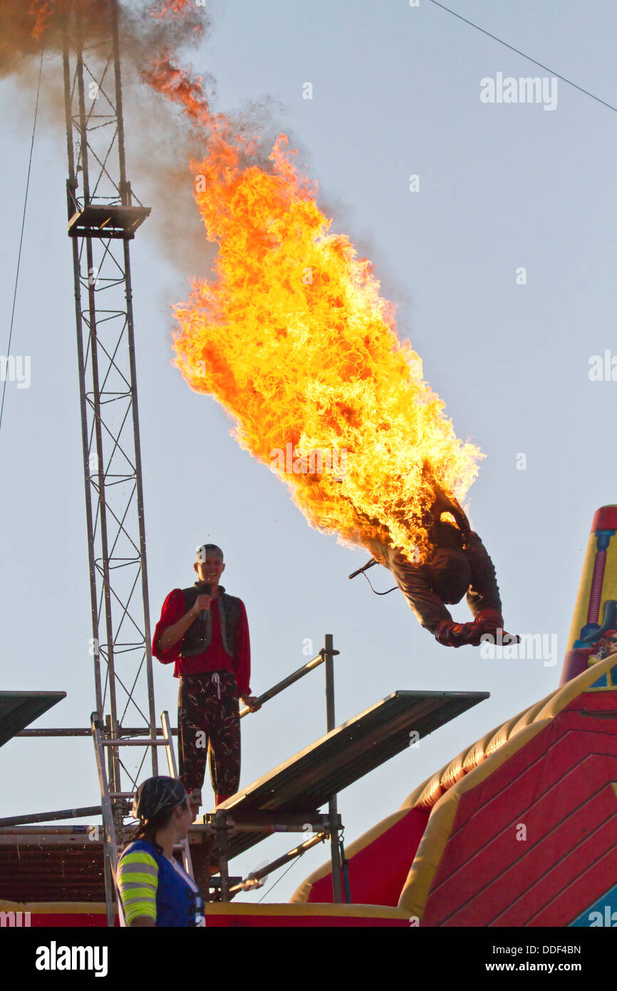 """A burning stunt man dives into water during the """"Pirate Ship"""" children's play at the 2011 Kentucky state fair. Kentucky, Stock Photo"""