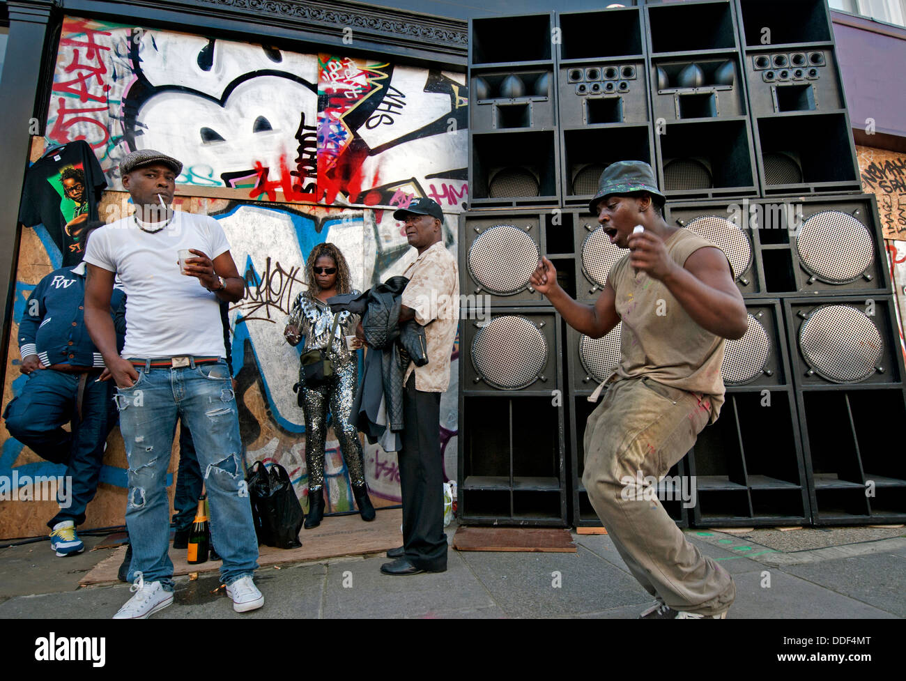 Side street with large sound system speakers at Notting Hill Carnival - Stock Image