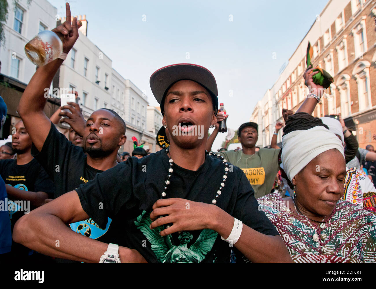Festival goers at Notting Hill Carnival in West London - Stock Image