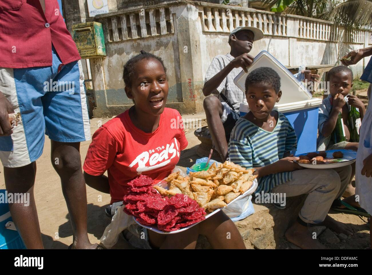 young street seller in Hell-Ville Andoany, Nosy Be island, Republic of Madagascar, Indian Ocean - Stock Image
