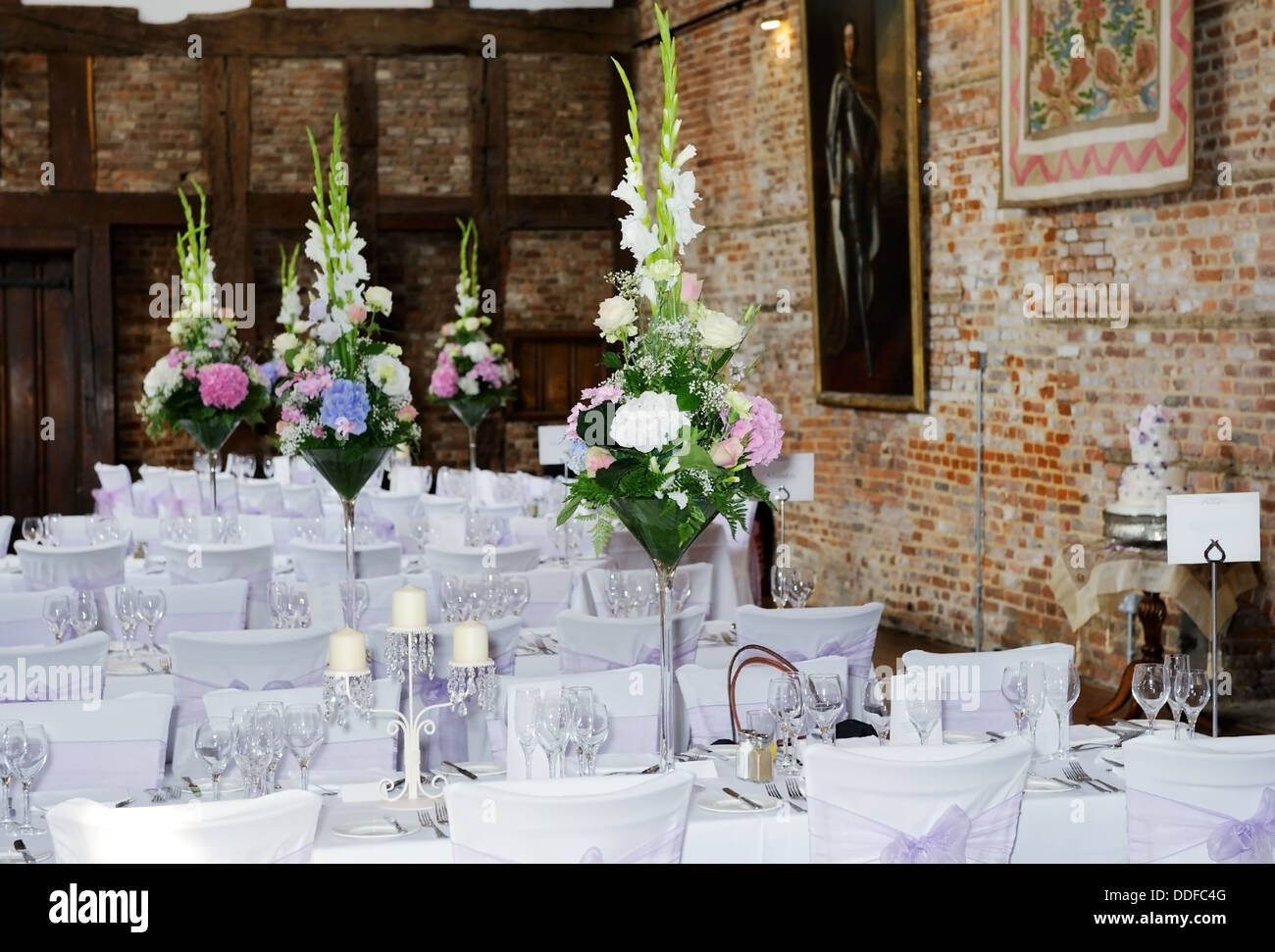 Wedding Reception Setting Showing Flower Arrangements On Table And