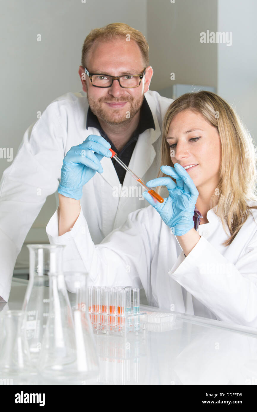 Portrait of young scientists working at the laboratory - Stock Image