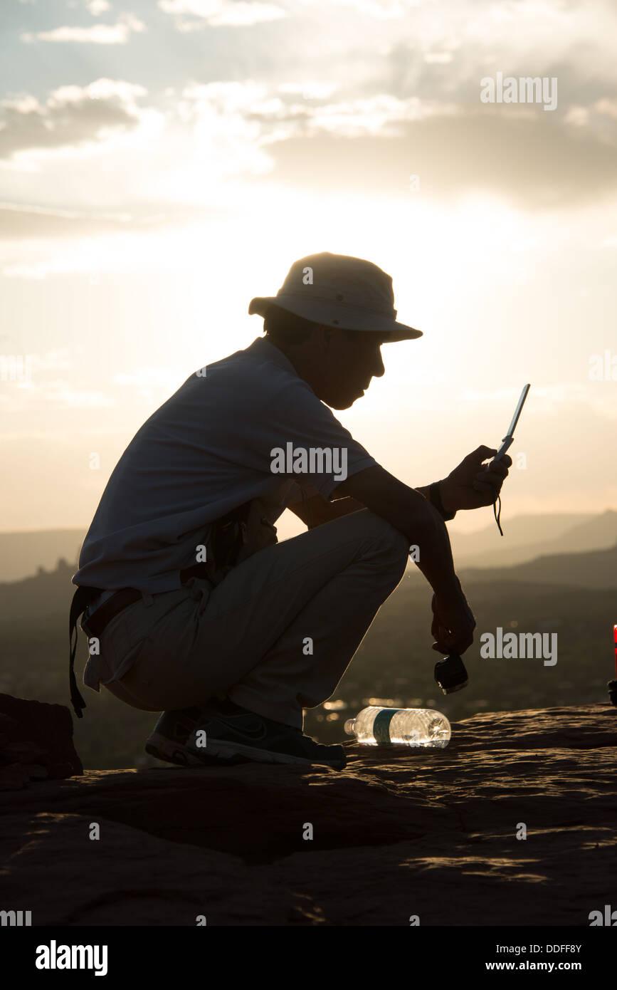 Man Texting Airport Vortex Sedona Arizona - Stock Image