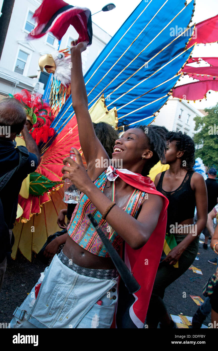 Young woman partaking in Notting Hill Carnival rnival - Stock Image