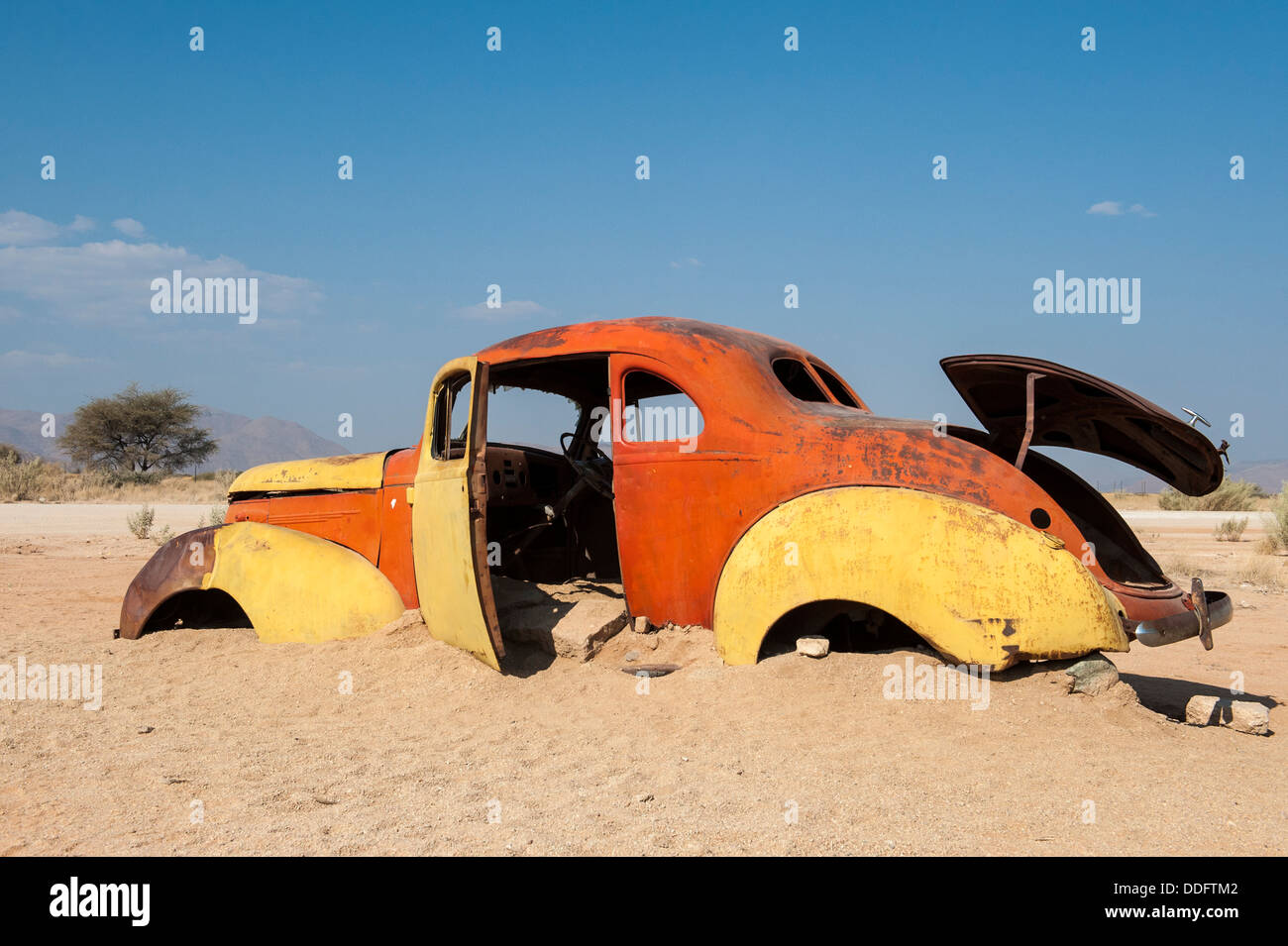 Old car wreck stuck in the sand at Solitaire, Khomas region, Namibia - Stock Image