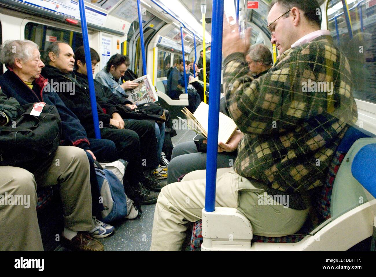 Commuters on a Tube train, London, England - Stock Image
