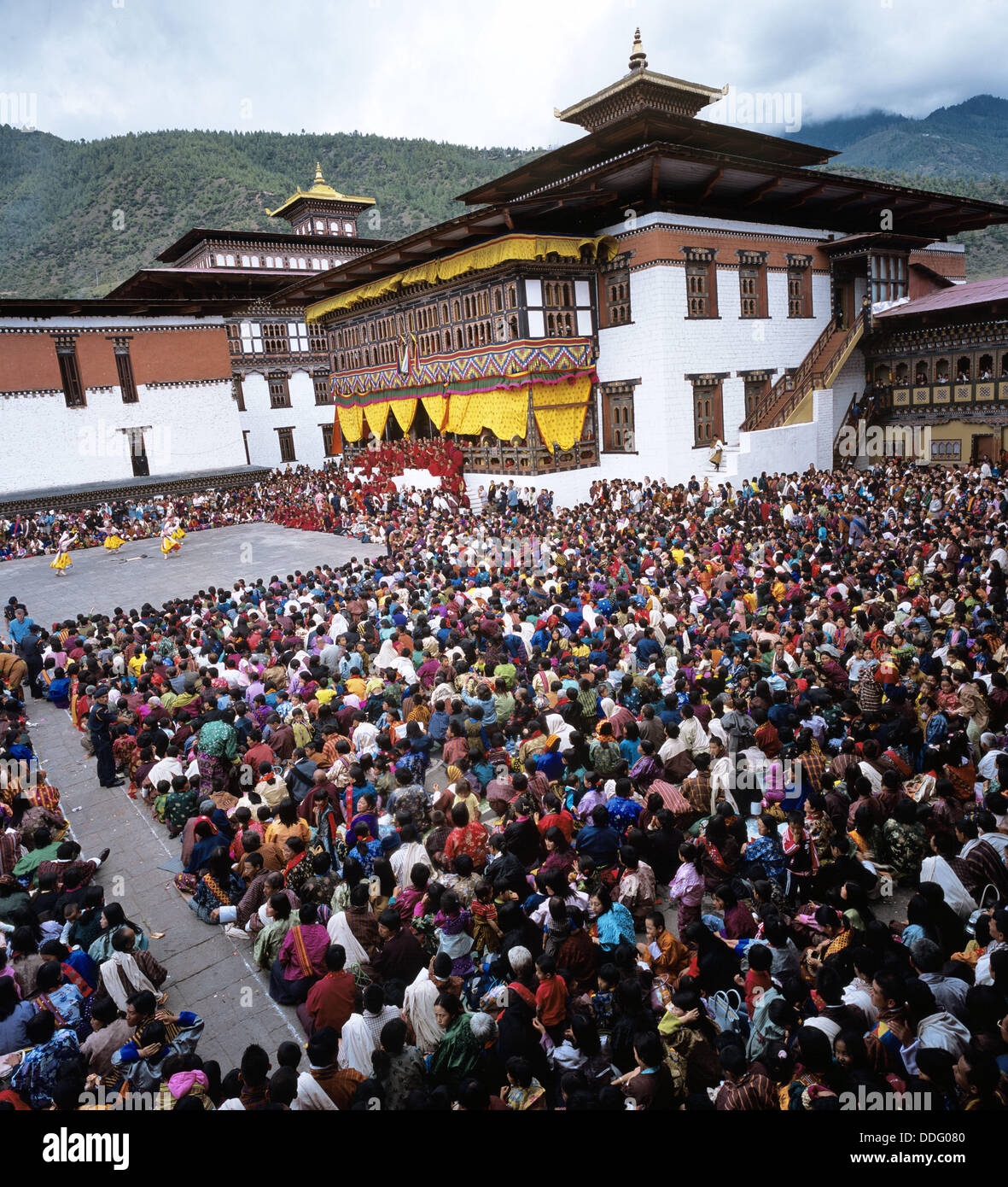 Bhutan. Thimphu Tsechu: pilgrims and believers gather to watch the religious festival in the capital city of Bhutan. - Stock Image
