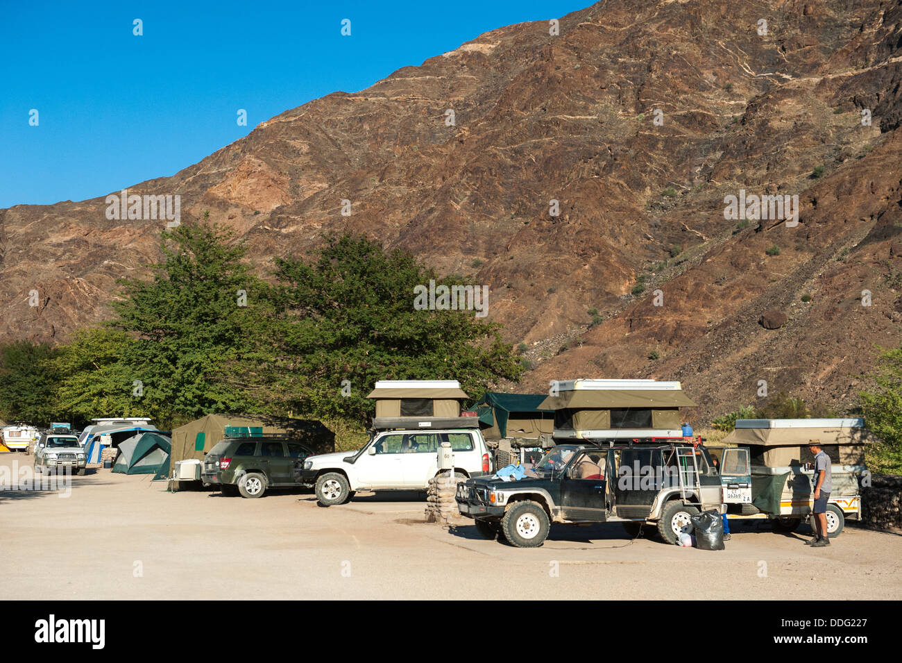 People with their camper vehicles at Ai-Ais campsite, Southern Region, Namibia - Stock Image