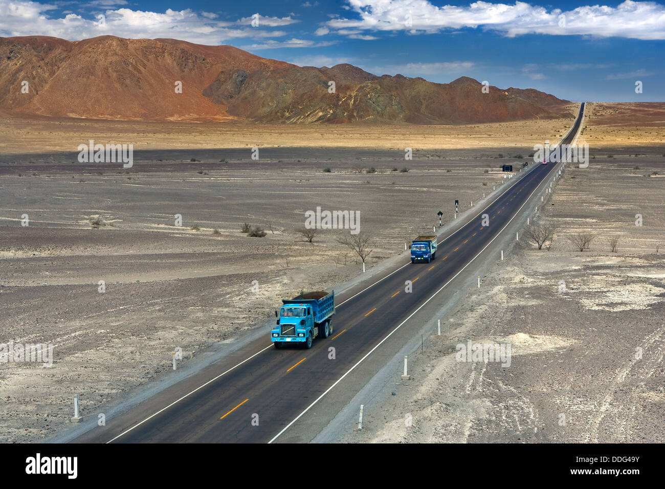 Pan-American highway, longest road in the world, stretching through the South American desert into the distance. - Stock Image