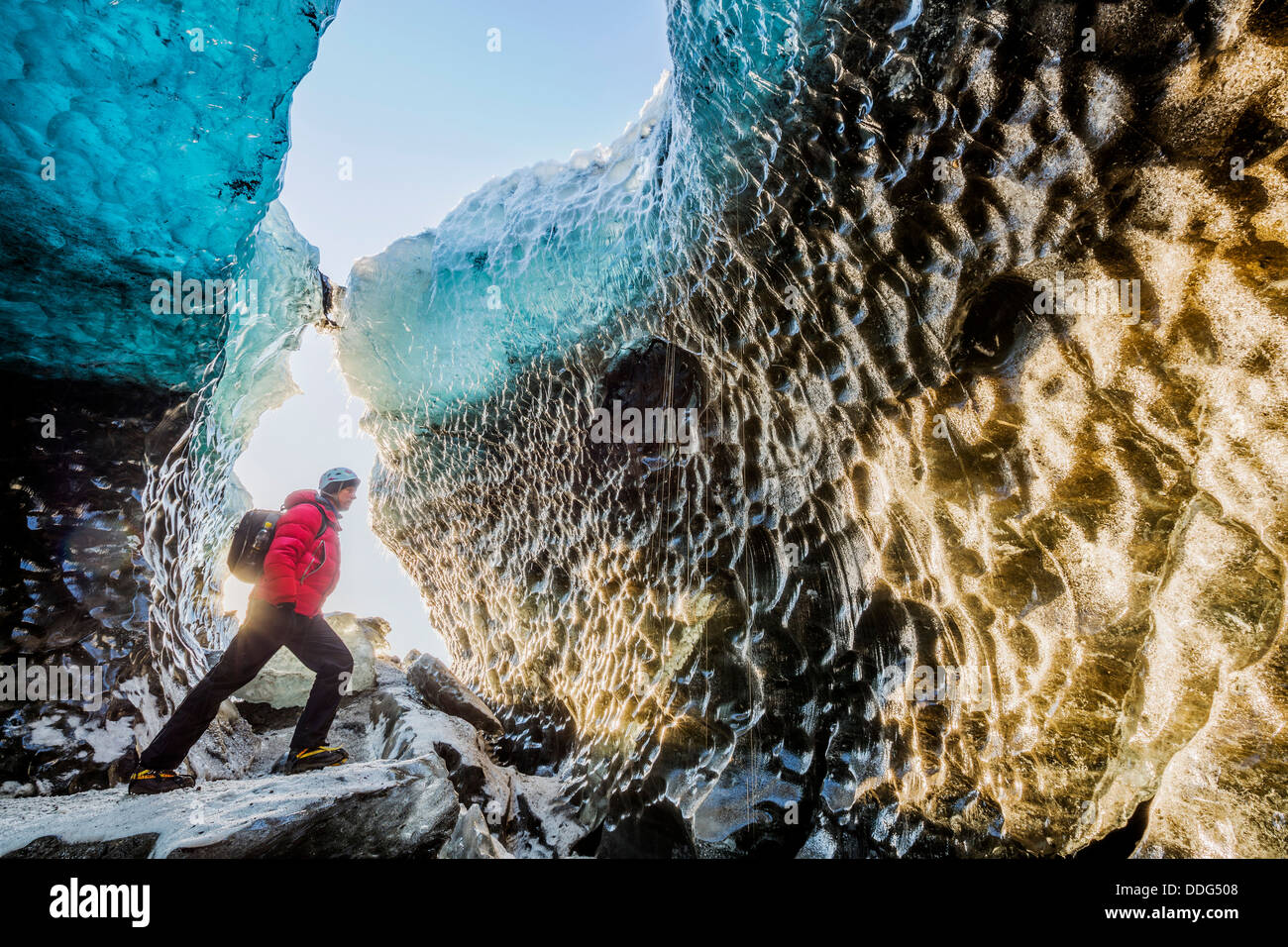 Exploring a glacial ice cave, Svinafellsjokull, Iceland - Stock Image