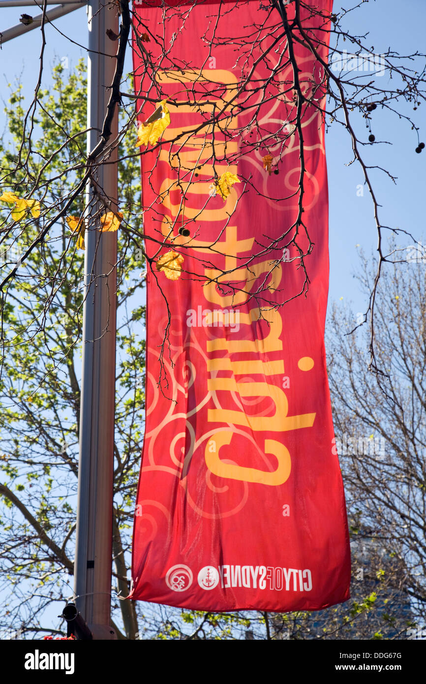 city of sydney erects banners in george street sydney, promoting chinatown and happiness - Stock Image