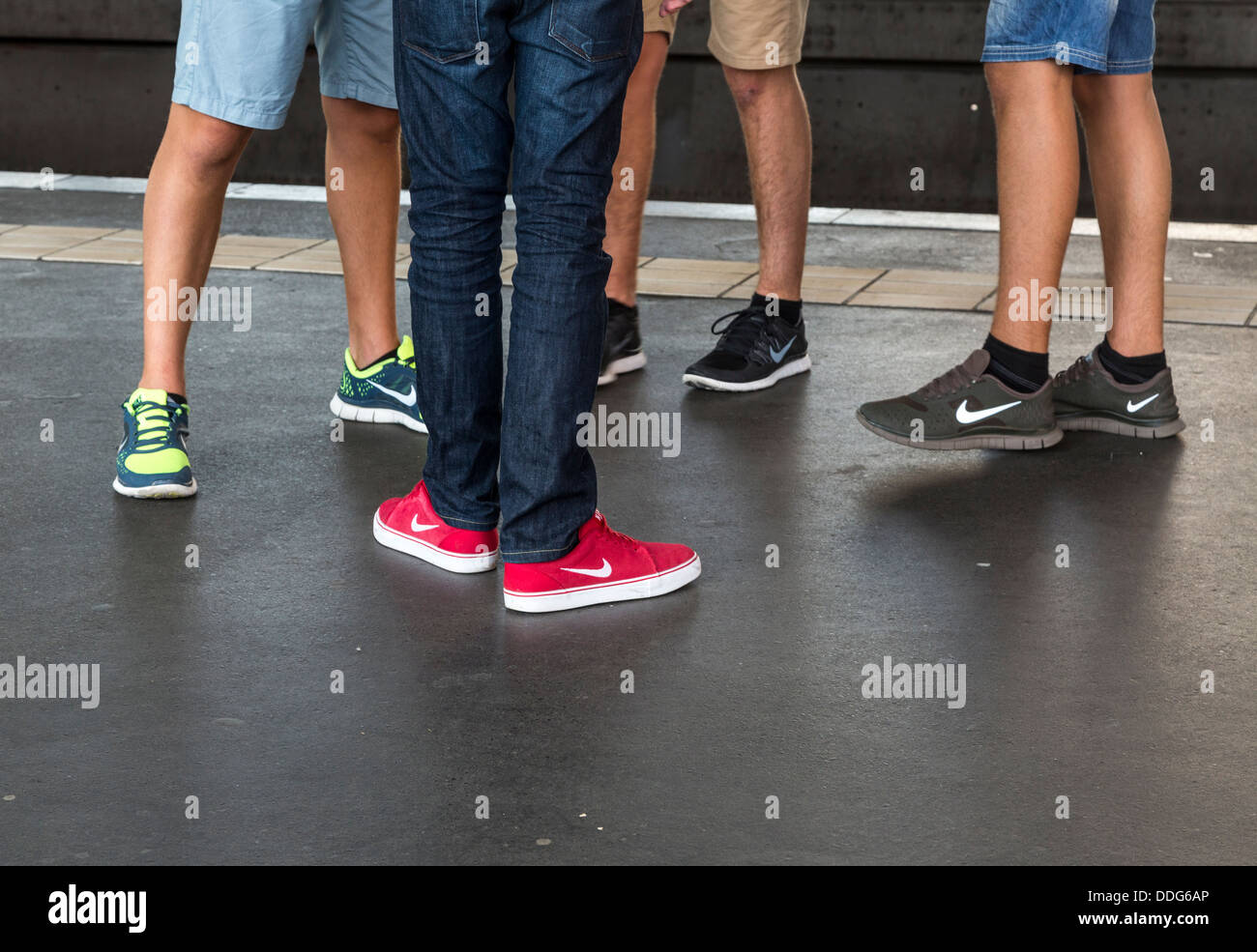 youths wearing Nike shoes, U-Bahn station, Berlin, Germany - Stock Image