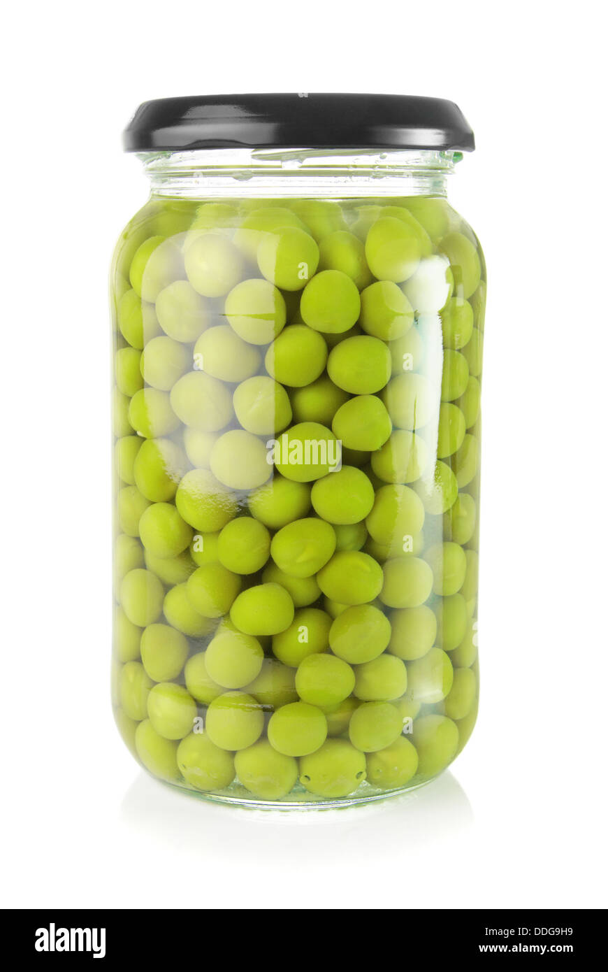 Preserved green peas in a glass jar - Stock Image