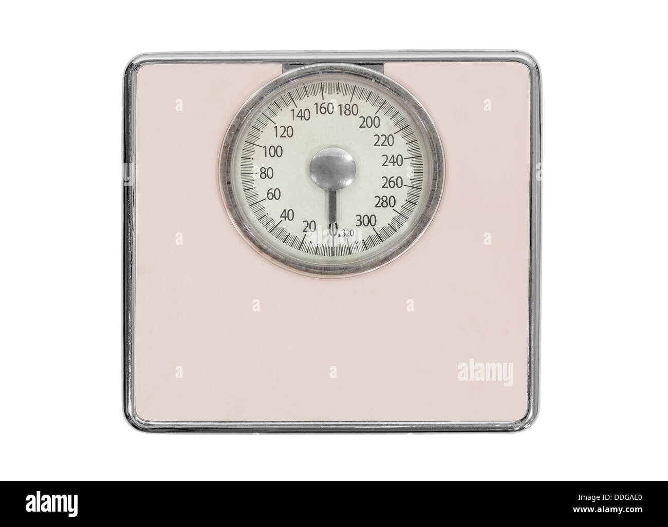 Old pink bathroom scale isolated with clipping path. - Stock Image