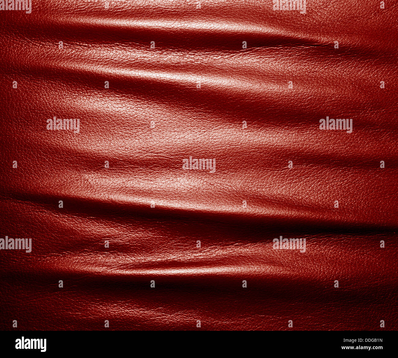 Soft wrinkled red leather texture background. - Stock Image