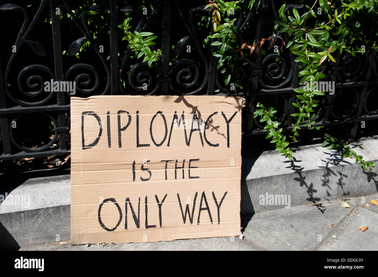 A hand painted sign on cardboard saying 'Diplomacy is the only way', at demo against intervention in Syria - Stock Image
