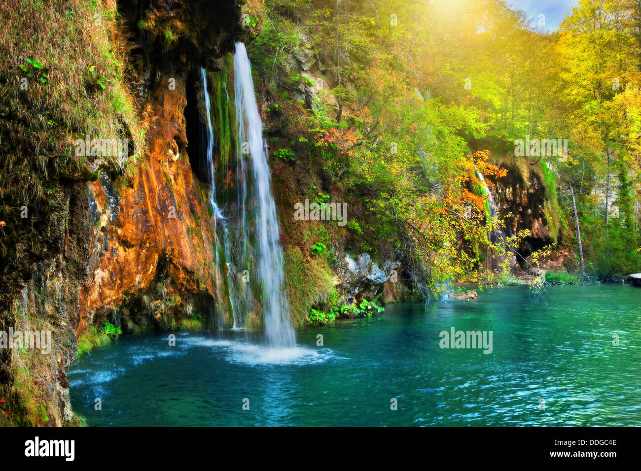 Waterfall in a forest in the Plitvice Lakes National Park, Croatia, Europe - Stock Image