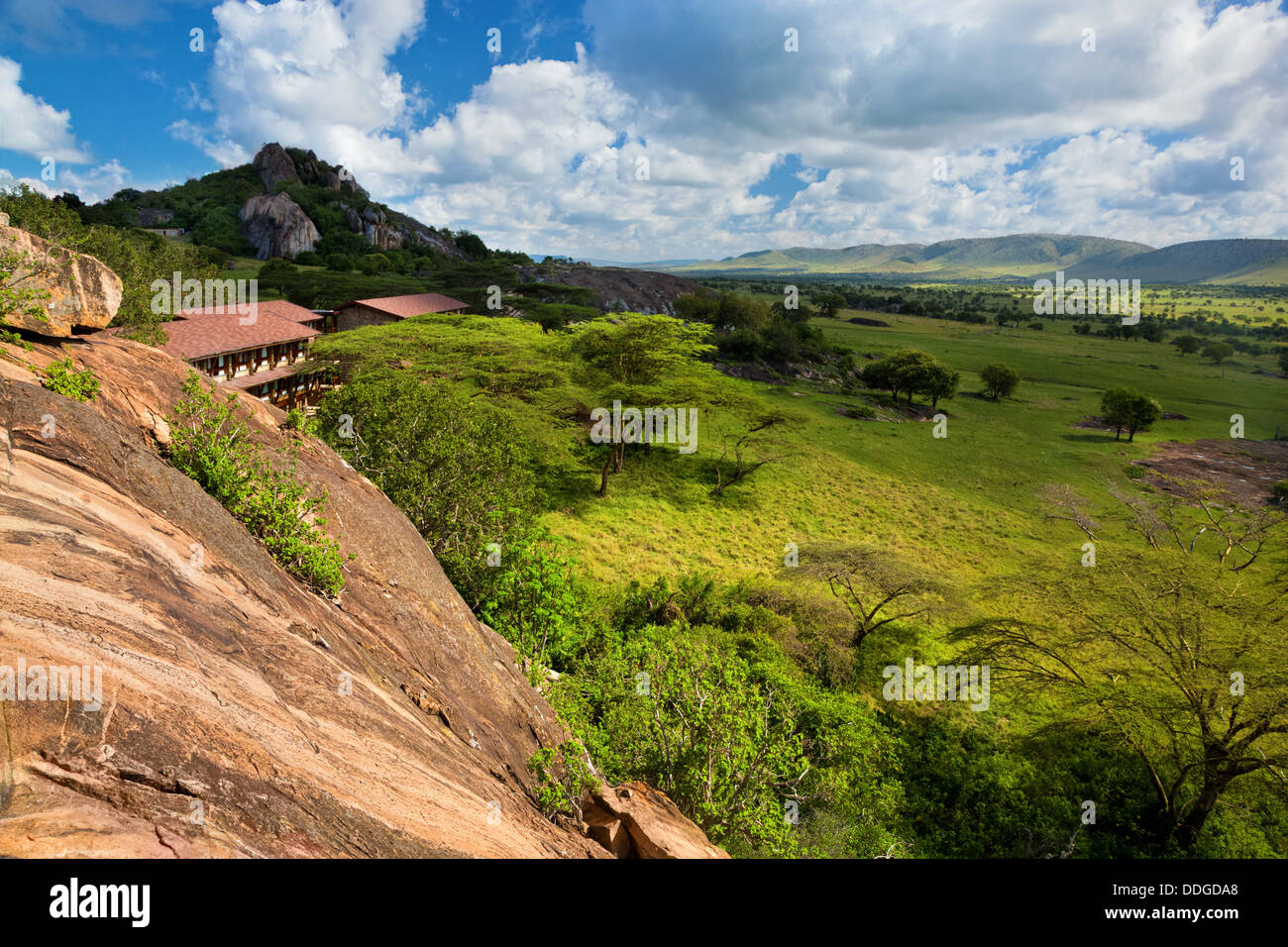 Savanna landscape and tourist lodge in the Serengeti National Park, Tanzania, Africa. - Stock Image