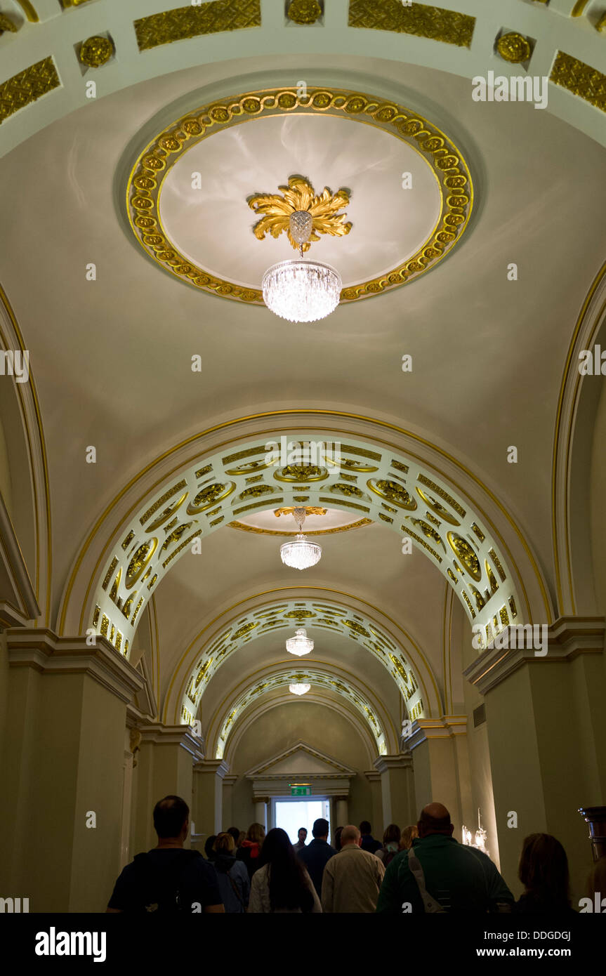 State corridor with plaster mouldings and waterford crystal lamps in Dublin castle, Ireland - Stock Image