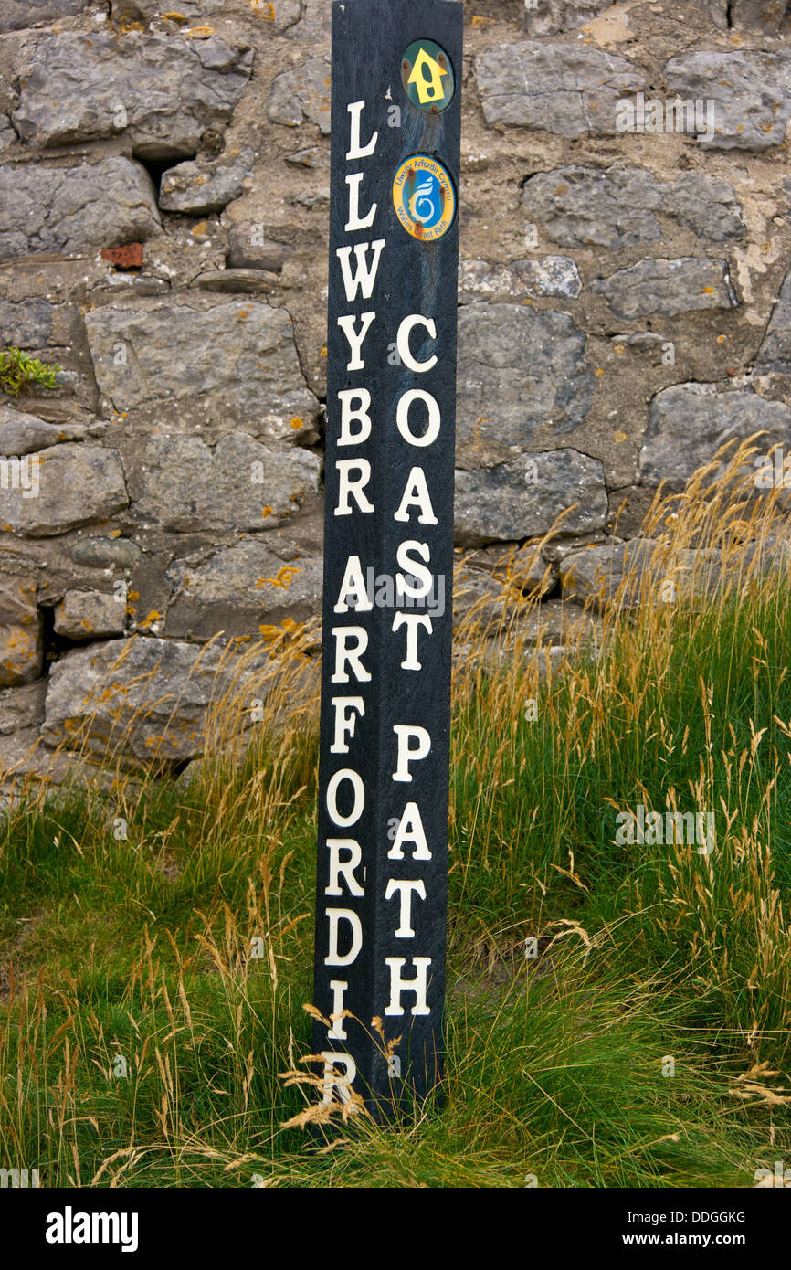 Wales coastal path sign in English and Welsh Porthcawl Wales Great Britain Europe - Stock Image