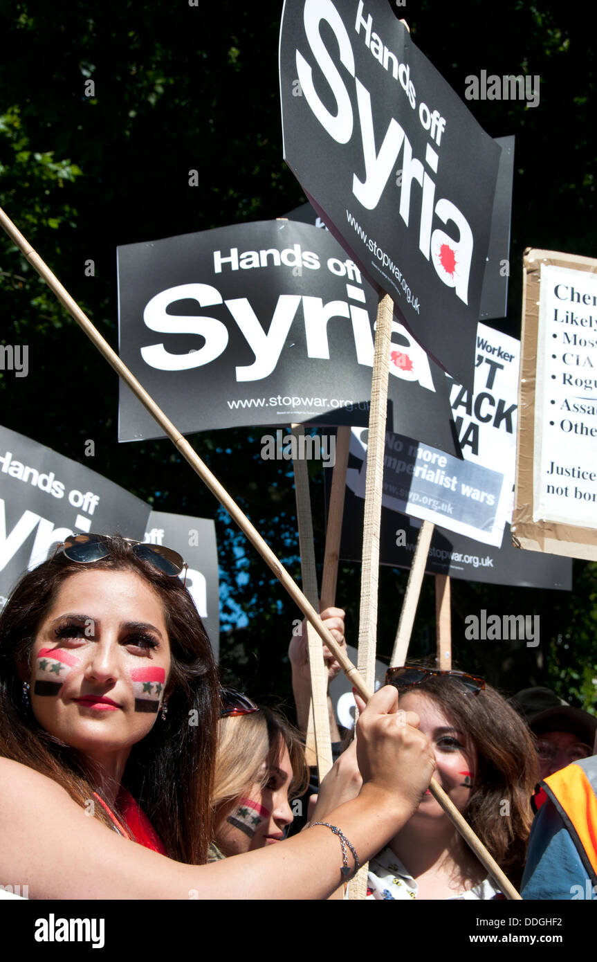 Young Syrian women with flags painted on their cheeks at demo against intervention in Syria Stock Photo