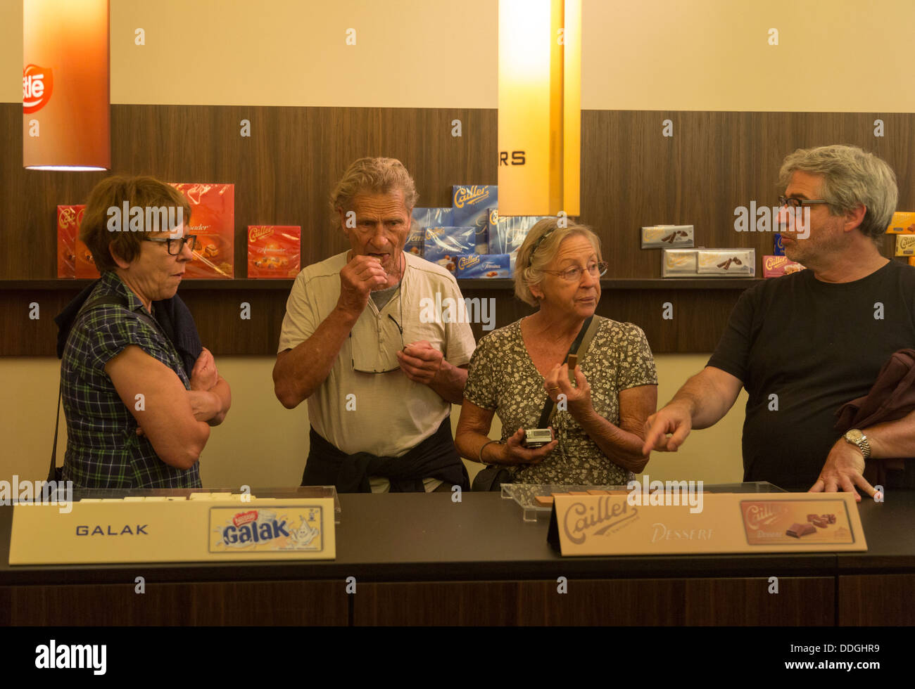 Chocolate tasting, Maison Cailler visitor center museum and factory tour, Broc, Switzerland - Stock Image