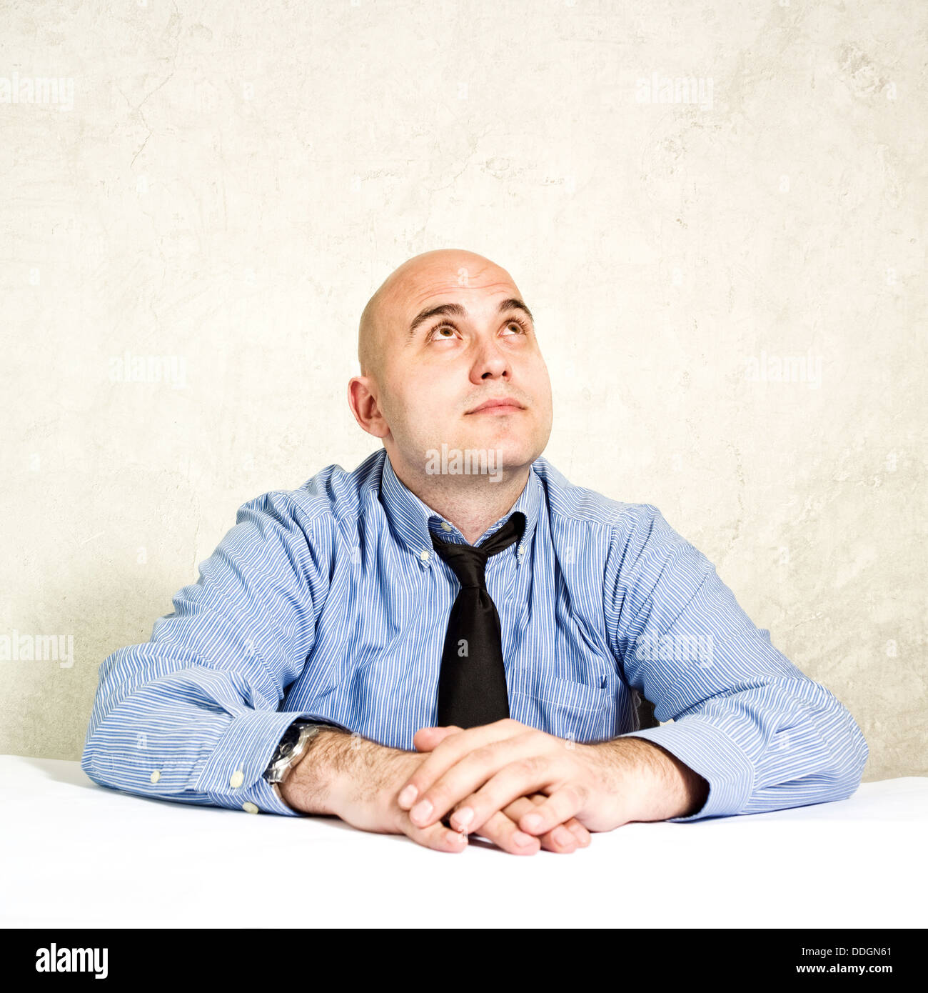 Businessman thinking, business choice or making decision. Businessman looking up. - Stock Image