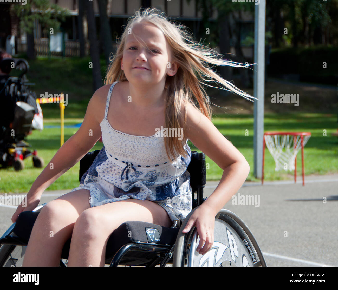 Girl in wheelchair - Stock Image
