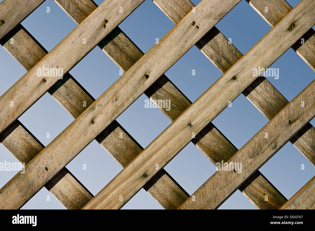 A Closeup Of A Wooden Lattice Fence With Blue Sky   Stock Image