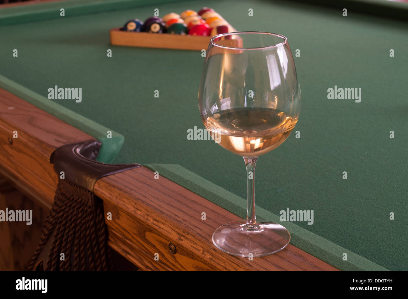 White Wine In A Single Clear Glass On A Pool Table With A Rack Of - Clear pool table